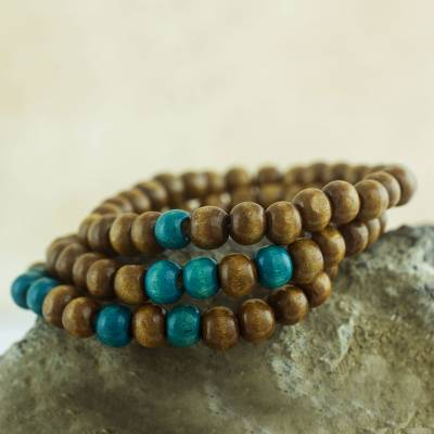 Wood stretch bracelets, 'Prayer' (set of 3) - Three Handcrafted Brown and Turquoise Wood Stretch Bracelets