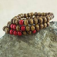 Wood stretch bracelets, 'Meditate' (set of 3) - Three Handcrafted Brown and Red Wood Stretch Bracelets