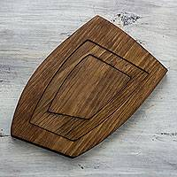 Wood trivet, 'Sharing Nature' - Adjustable Adaptable Hand Crafted Alder Wood Trivet