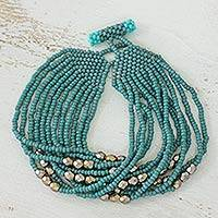 Beaded bracelet, 'Aquatic Feast' - Artisan Crafted Turquoise and Acqua Colors Beaded Bracelet