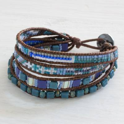 Beaded wristband bracelet, 'Sparkling Moon' - Handmade Four Strand Blue Bead Bracelet with Leather Binding