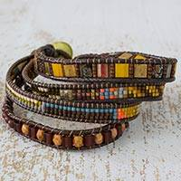 Beaded wristband bracelet, 'Fertile Lands' - Handmade Four Strand Multi colour Bead Bracelet with Leather