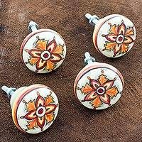 Ceramic knobs, 'Orange Glow' (set of 4) - Hand Crafted Ceramic Knobs with Floral Motif (Set of 4)