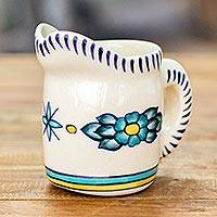 Ceramic creamer, 'Bermuda' - Hand Crafted White Ceramic Creamer with Floral Motif
