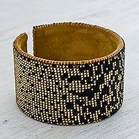 Beaded leather cuff bracelet, 'Warm Starlight' - Contemporary Black and Ochre Hand Beaded Cuff Bracelet
