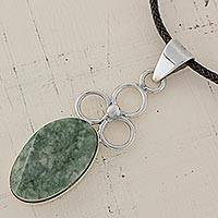 Jade pendant necklace, 'Circles of Love' - Jade Oval Pendant Necklace Handmade in Guatemala