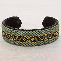 Beaded cuff bracelet, 'Tortoise Path' - Green and Black Glass Beaded Cuff Bracelet from El Salvador
