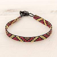 Beaded wristband bracelet, 'Chichicastenango Character' - Thin Glass Bead Wristband Bracelet Red Gold from Guatemala