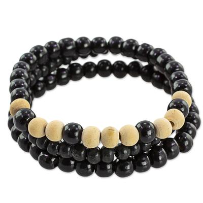Wood beaded stretch bracelets, 'Black Force' (set of 3) - Beige and Black Wood Beaded Bracelets (Set of 3) Guatemala