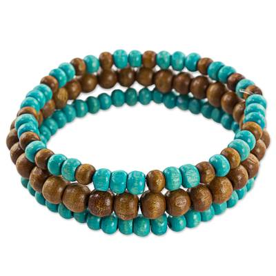 Wood beaded stretch bracelets, 'Blue Force' (set of 3) - Brown and Blue Wood Beaded Bracelets (Set of 3) Guatemala