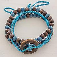 Wood and cotton beaded bracelets, 'Ring of Serenity' (set of 3) - Set of 3 Brown and Blue Guatemalan Beaded Wood Bracelets