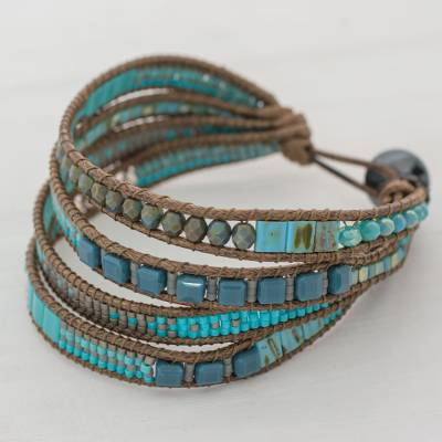 Glass beaded wristband bracelet, 'Celestial Valley' - Hand Made Glass Bead Wristband Bracelet Blue from Guatemala