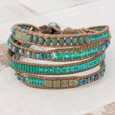 Glass beaded wristband bracelet, 'Glistening Lake' - Glass Beaded Wristband Bracelet in Cerulean from Guatemala