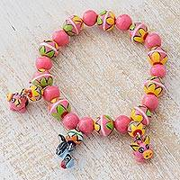 Ceramic beaded stretch bracelet, 'Pink Festivity' - Ceramic Bracelet with Pigs and Parrot from Guatemala