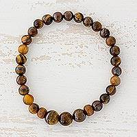 Tiger's eye beaded stretch bracelet, 'Earthen Love' - Tiger's Eye and Pinewood Beaded Bracelet from Guatemala
