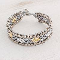 Glass beaded wristband bracelet, 'Cobbled Roads' - Diamond-Motif Glass Beaded Bracelet from Guatemala
