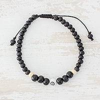 Wood beaded bracelet, 'Concentration' - Pinewood Beaded Bracelet in Black from Guatemala