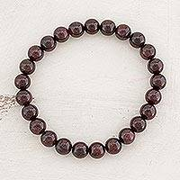 Garnet beaded stretch bracelet, 'Offering of Love' - Natural Garnet Beaded Stretch Bracelet from Guatemala