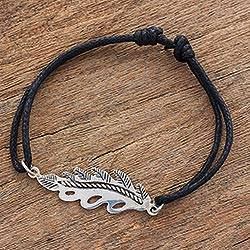 Sterling silver pendant bracelet, 'Lifeline' - Black Cotton Cord and Sterling Silver Leaf Pendant Bracelet