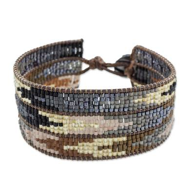 Glass beaded wristband bracelet, 'Mountain Guide' - Arrow Motif Glass Beaded Wristband Bracelet from Guatemala