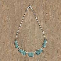 Jade pendant necklace, 'Hidden Beauty' - Sterling Silver and Light Green Jade Pendant Necklace