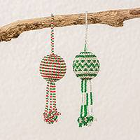 Glass beaded ornaments, 'Holiday Sharing' (pair) - Handcrafted Green White and Red Glass Bead Ornaments (Pair)