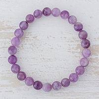 Amethyst beaded stretch bracelet, 'Purple with Love' - Amethyst Beaded Stretch Bracelet from Guatemala