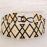 Glass beaded wristband bracelet, 'Intersections' - Black and Yellow Geometric Woven Bead Wristband Bracelet