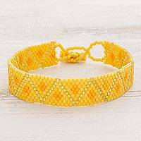 Beaded wristband bracelet, 'Meandering Sun' - Yellow Geometric Beaded Wristband Bracelet
