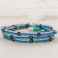Beaded wrap bracelet, 'Ocean Blooms' - Blue and Black Flower and Stripes Beaded Wrap Bracelet
