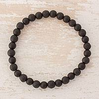 Onyx and lava stone beaded stretch bracelet, 'Dark Earth' - Guatemalan Black Onyx and Lava Stone Beaded Stretch Bracelet