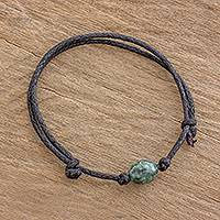 Jade pendant bracelet, 'Mayan Allure' - Black Cotton Braided Pendant Bracelet with Green Jade
