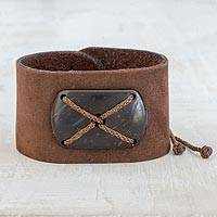 Leather wristband bracelet, 'Powerful' - Brown Leather Coconut Shell Pendant Wristband Bracelet