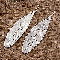 Sterling silver drop earrings, 'Hammered Leaf' - Handcrafted Elongated Leaf Sterling Silver Drop Earrings