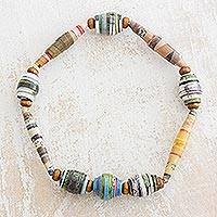 Recycled paper bead stretch bracelet, 'Revitalize' - Handcrafted Colorful Recycled Paper Beaded Stretch Bracelet