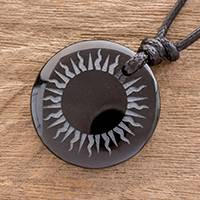 Jade pendant necklace, 'Total Eclipse' - Carved Sun on Black Jade Round Pendant Cord Necklace