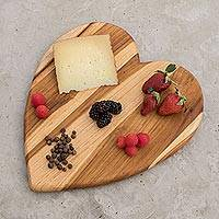 Teak wood cutting board, 'Heart of Cooking' - Heart-Shaped Teak Wood Cutting Board from Guatemala