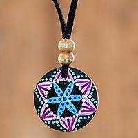 Wood pendant necklace, 'Vibrant Seed in Black' - Floral Pinewood Pendant Necklace in Black from Guatemala