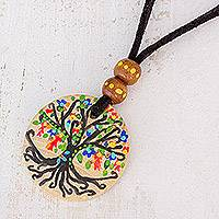 Wood pendant necklace, 'Magical Tree' - Tree Motif Pinewood Pendant Necklace from Guatemala