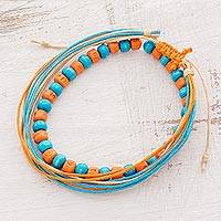 Men's wood beaded bracelets, 'Surf's Up' (pair) - Men's Blue Orange Wood Bead and Cotton Cord Bracelets (Pair)