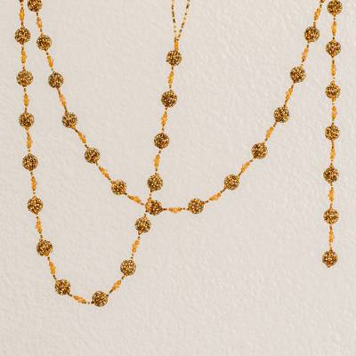 Glass beaded garland, 'Golden Silhouettes' - Glass Beaded Garland in Orange from Guatemala