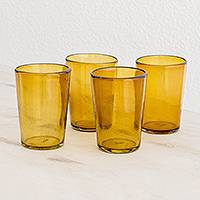 Recycled glass juice glasses, 'Icy Amber' (set of 4) - Handblown Recycled Glass Amber Juice Glasses (Set of 4)