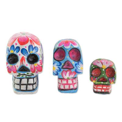Wood figurines, 'Life and Color' (set of 3) - Wood Floral Skull Figurines from Guatemala (Set of 3)