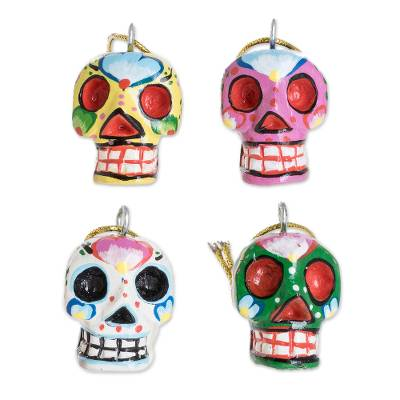 Wood ornaments, 'Traditional Skulls' (set of 4) - Wood Floral Skull Ornaments from Guatemala (Set of 4)
