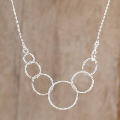 Sterling silver pendant necklace, 'Linked Orbits' - Circle Motif Sterling Silver Pendant Necklace from Guatemala