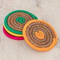 Pine needle coasters, 'Coiled Colors' (set of 4) - Multicolored Pine Needle Coasters from Nicaragua (Set of 4)