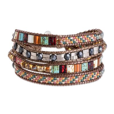 Glass beaded wristband bracelet, 'Beneath the Ocean' - Colorful Glass Beaded Wristband Bracelet from Guatemala