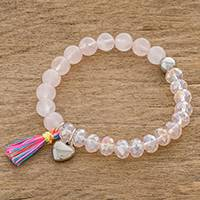 Rose quartz beaded stretch bracelet, 'Innocent Love' - Rose Quartz Heart Charm Beaded Stretch Bracelet