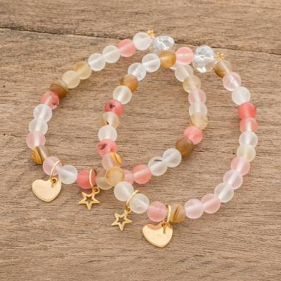 Quartz beaded stretch bracelets, 'Lovely Coral' (pair) - Heart and Star Charm Quartz Beaded Stretch Bracelets (Pair)