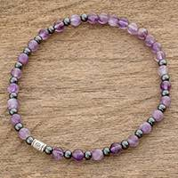 Amethyst beaded stretch bracelet, 'Amethyst Rain' - Amethyst Beaded Stretch Bracelet from Mexico